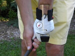 Close-up view of GOLFSTR locking the wrist when chipping
