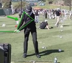 Sean OHair is demonstrating the first critical move in your backswing:  Both arms straight to force the rotation of you chest 70 degrees away from the target line.